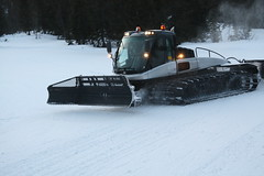 auto racing(0.0), racing(0.0), winter sport(0.0), winter(1.0), vehicle(1.0), snow(1.0), snow removal(1.0), snowplow(1.0), land vehicle(1.0),