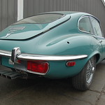 Old Jaguar E-type sports car: back fender & exhaust pipe array