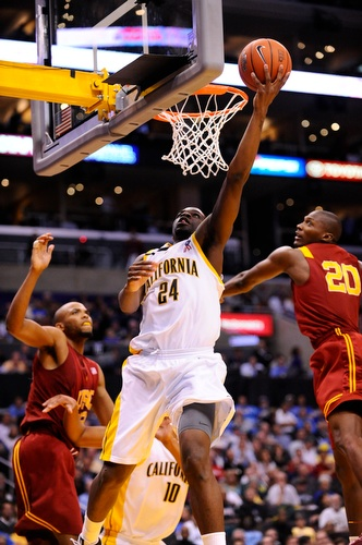 California's Theo Robertson (24) makes a shot between USC's Taj Gibson (22) and Marcus Simmons (20) during the second half of No. 6 USC's 79–75 victory over No. 3 California in the quarterfinal game of the Pac-10 Tournament at the Staples Center on March 12, 2009.