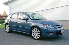 sedan(0.0), automobile(1.0), automotive exterior(1.0), executive car(1.0), family car(1.0), wheel(1.0), vehicle(1.0), mazda(1.0), mid-size car(1.0), compact car(1.0), bumper(1.0), mazdaspeed3(1.0), land vehicle(1.0),
