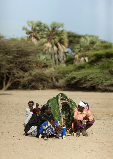 Gabbra people crouching in the desert - Kenya
