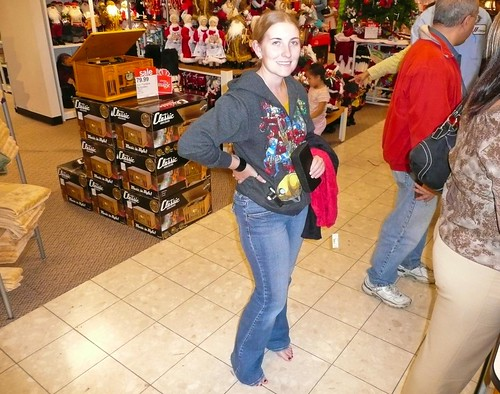 Sarah putting on a brave face during last minute Christmas shopping a few years ago.  Really… she did great.  Only two people died and JC Penny finally lifted the ban on her concealed sword.  Life is good.