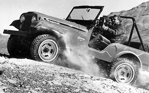 1972_Jeep_CJ_5_Renegade_with_304_CID_V_8_Going_Uphill_Off_Road_Frt_Qtr_BW