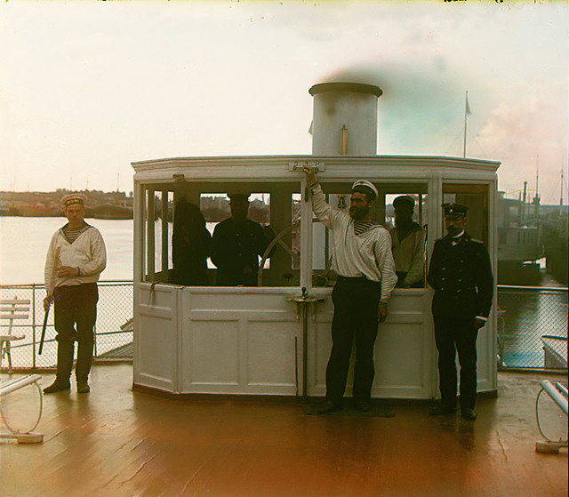 At the wheelhouse of Sheksna steamer, 1909