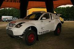 auto racing(0.0), racing(0.0), compact sport utility vehicle(0.0), mitsubishi(0.0), automobile(1.0), automotive exterior(1.0), rallying(1.0), sport utility vehicle(1.0), mini sport utility vehicle(1.0), wheel(1.0), vehicle(1.0), off-roading(1.0), rally raid(1.0), off-road vehicle(1.0), bumper(1.0), land vehicle(1.0),