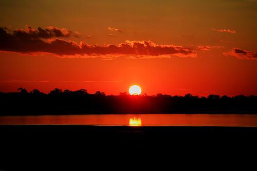 sunset red peru southamerica river jungle amazonia madrededios
