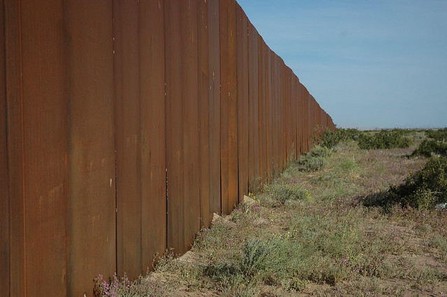 I hope someone tears down The Wall, US border, separating Mexico from the US, looking east, along Highway 2, Sonora Desert, Mexican side