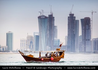 Qatar - Old & New - Traditional Dhow in front of Doha Cityscape