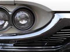 wheel(0.0), supercar(0.0), automobile(1.0), automotive exterior(1.0), vehicle(1.0), automotive lighting(1.0), automotive design(1.0), light(1.0), grille(1.0), bumper(1.0), headlamp(1.0), land vehicle(1.0),
