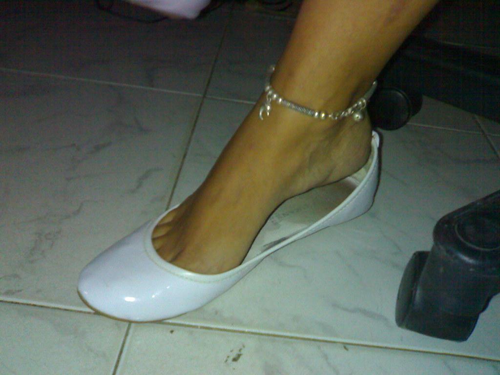 Sexy heelpopping feet shoeplay at council meeting
