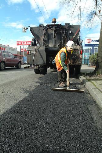 """Pothole ranger"" repairing street, 2003"