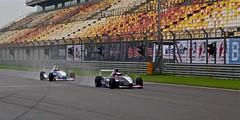 auto race(0.0), race car(1.0), auto racing(1.0), racing(1.0), sport venue(1.0), vehicle(1.0), sports(1.0), race(1.0), race of champions(1.0), motorsport(1.0), race track(1.0), stadium(1.0),