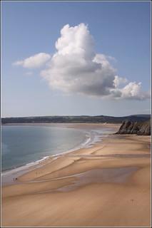 Image of Pobbles Beach near Southgate. sea sky castle wales clouds geotagged coast rocks gower threecliffsbay pennard cliifs parkmill geo:lat=51569348 geo:lon=4105968