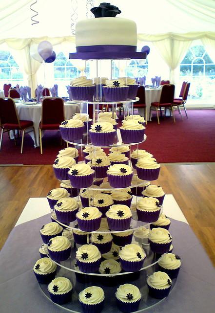 Purple wedding cupcakes and cutting cake