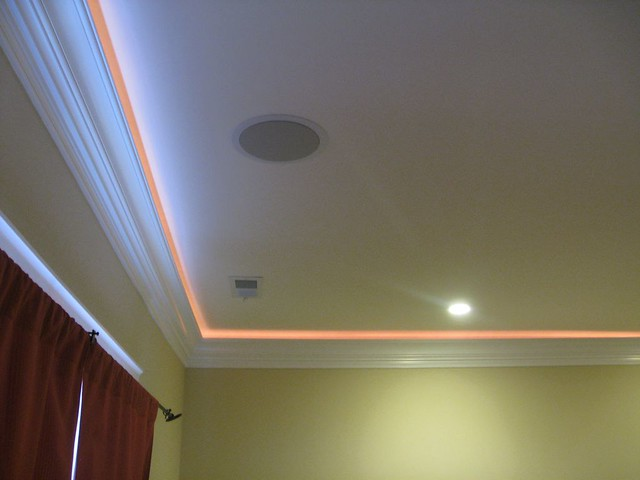 crown molding with lights and speakers in master bedroom
