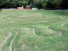 outdoor structure(0.0), field(0.0), soil(0.0), lawn(0.0), road surface(0.0), walkway(0.0), flooring(0.0), garden(1.0), grass(1.0), plain(1.0), labyrinth(1.0), landscape(1.0),