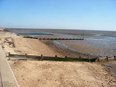 beach(0.0), reservoir(0.0), salt evaporation pond(0.0), shore(0.0), coast(0.0), sand(1.0), sea(1.0), breakwater(1.0), geology(1.0), natural environment(1.0), mudflat(1.0), terrain(1.0), infrastructure(1.0),