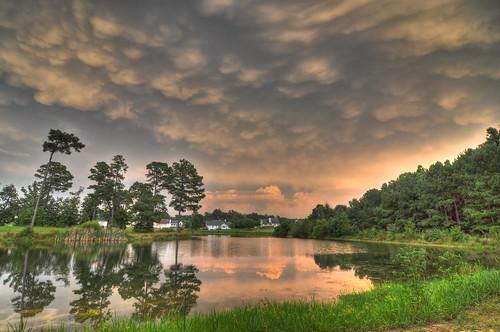 sky lake nature clouds landscape northcarolina coats pinetrees stormclouds waterreflection cumulonimbusmammatus