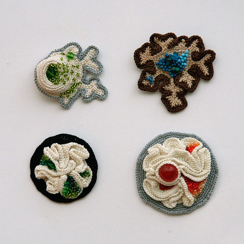 Four new brooches
