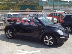 minivan(0.0), automobile(1.0), volkswagen beetle(1.0), automotive exterior(1.0), wheel(1.0), volkswagen(1.0), vehicle(1.0), automotive design(1.0), volkswagen new beetle(1.0), subcompact car(1.0), city car(1.0), sedan(1.0), land vehicle(1.0),