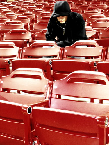 light red portrait selfportrait black face crimson self hoodie glow bright seat numbers rows seats same repetition glowing repeat identical cloaked disguised in hundreds grandstands colourartaward greeneyephoto inthecrimsongrandstands