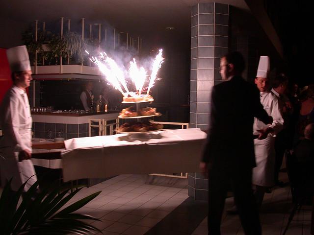 Big Birthday Cake Sparklers Carried Through Restaurant