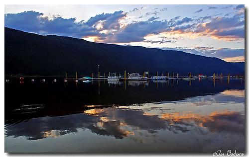 sunset lake mountains beach water beautiful clouds reflections landscape boats scenery bc view mara