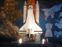 airplane(0.0), rocket(1.0), space shuttle(1.0), spacecraft(1.0), vehicle(1.0), space(1.0),