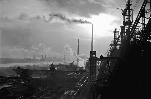 Thyssen steel-works in Muelheim, West-Germany.In the background the Rhine-river. In 1955,smoking chimneys were a welcome sign of recovery, by Erich Lessing
