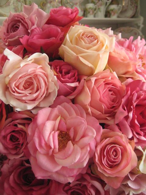 PInk roses in floral swag urn