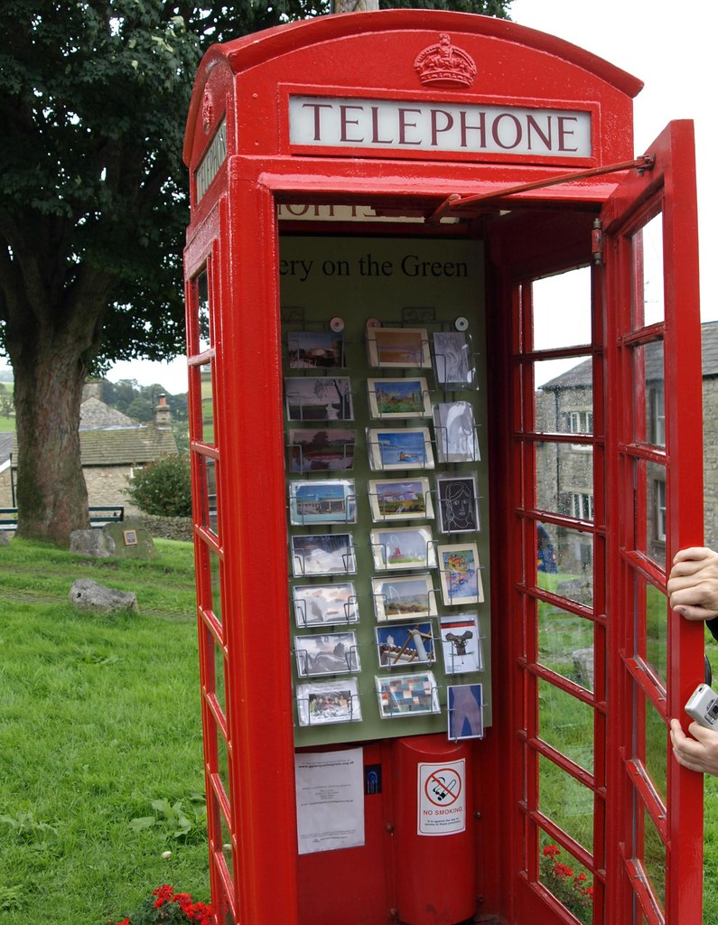 Gallery on the Green in Settle - Postcard art in a red phone box
