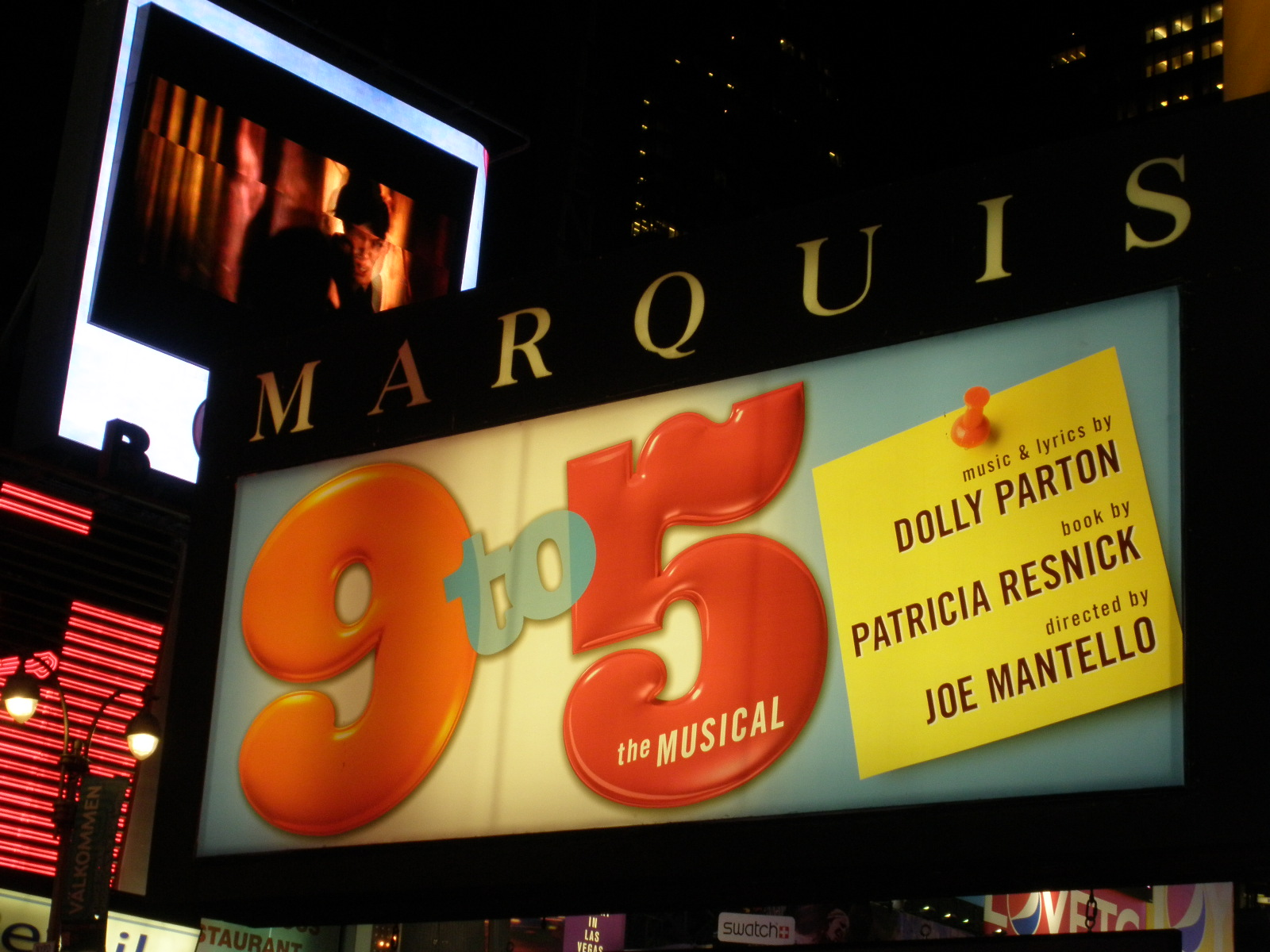 "Lit up theater sign that says ""9 to 5"""