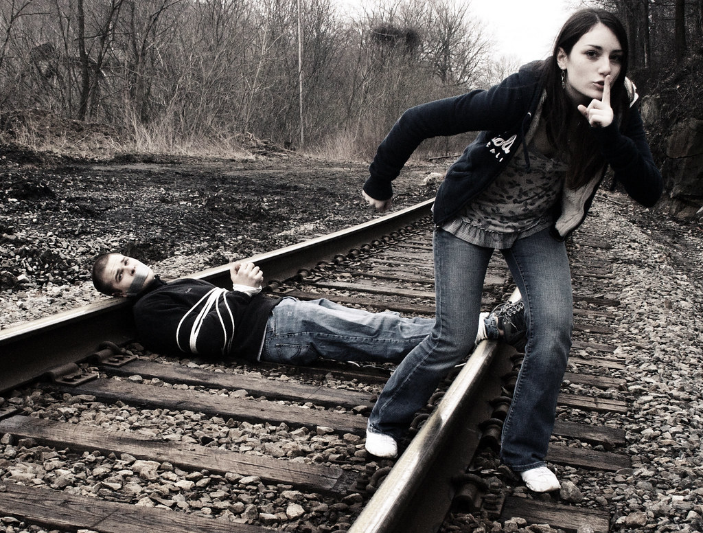 Valuable Girl tied to tracks something is