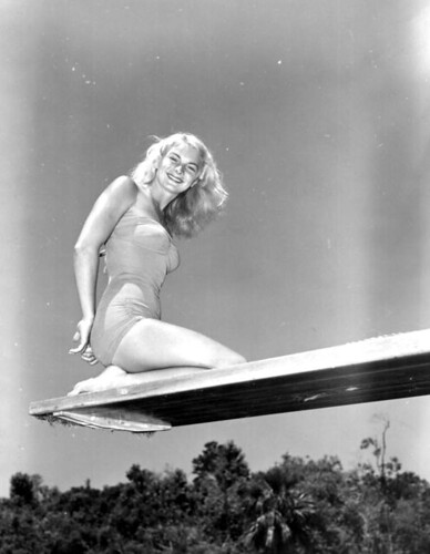 Portrait of Ginger Stanley kneeling on a diving board: Weeki Wachee Springs, Florida