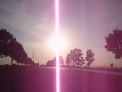 lightning(0.0), rainbow(0.0), purple(0.0), dawn(0.0), cloud(1.0), sunlight(1.0), sun(1.0), morning(1.0), pink(1.0), sky(1.0), lens flare(1.0),