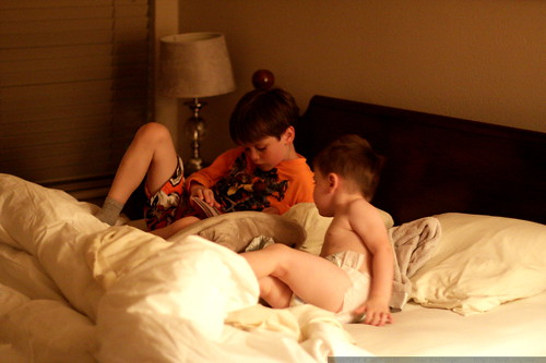 nick reading sequoia a bedtime story in our hotel room