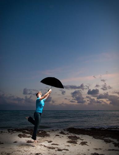 sunset selfportrait beach umbrella jump jumping flash abi bahiahonda flyaway jumpshot sb800 thankseveryone 365days strobist yayexplore