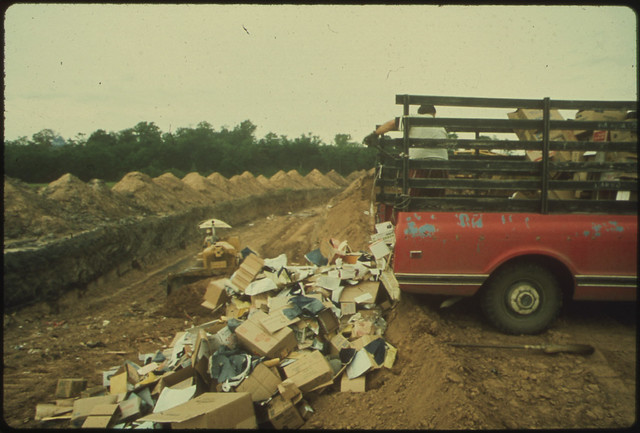Solid Waste Is Dumped Into Trenches at a Sanitary Landfill, by Jim Olive for Documerica. Fort Smith, AR. June, 1972.