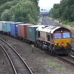 66193 comes off the main line with an intermodal at Water Orton 30 July 2009