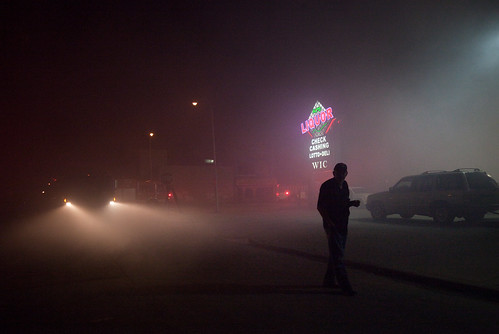 The Fire:  Walking, Liquor Sign in the Haze