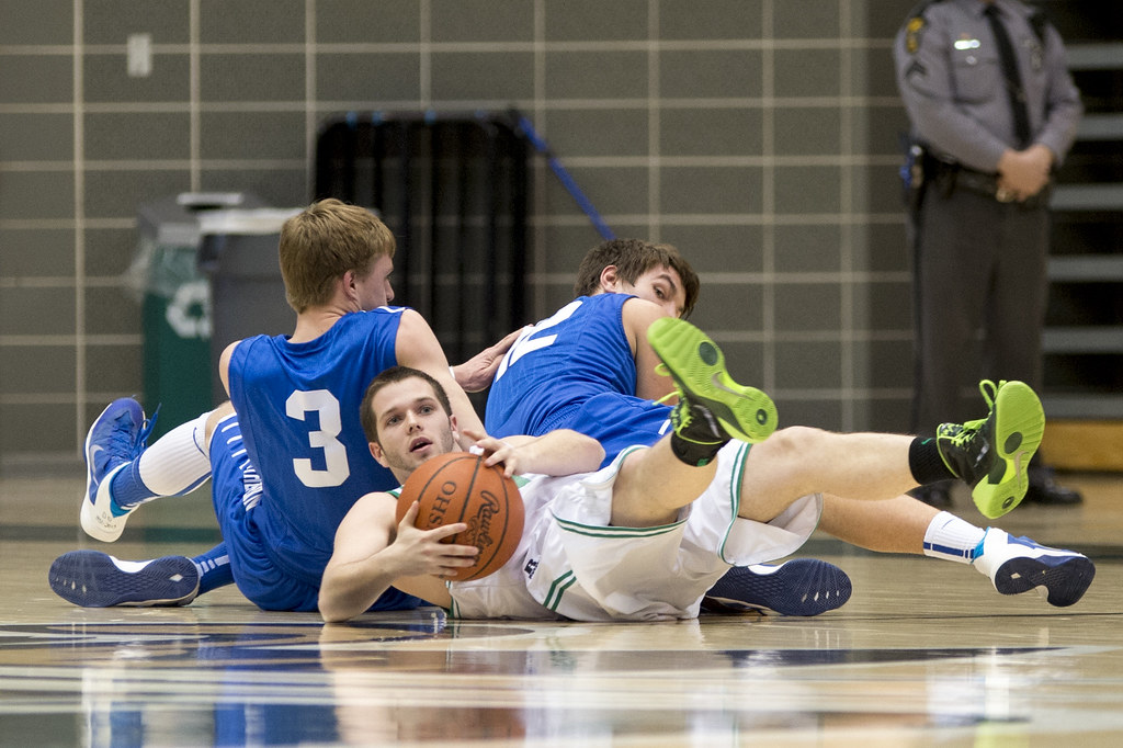 Jacob Warner comes up with a loose ball for the Dragons.