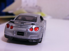 model car(1.0), automobile(1.0), automotive exterior(1.0), wheel(1.0), vehicle(1.0), automotive design(1.0), nissan gt-r(1.0), nissan(1.0), bumper(1.0), land vehicle(1.0), luxury vehicle(1.0), coupã©(1.0), supercar(1.0), sports car(1.0),