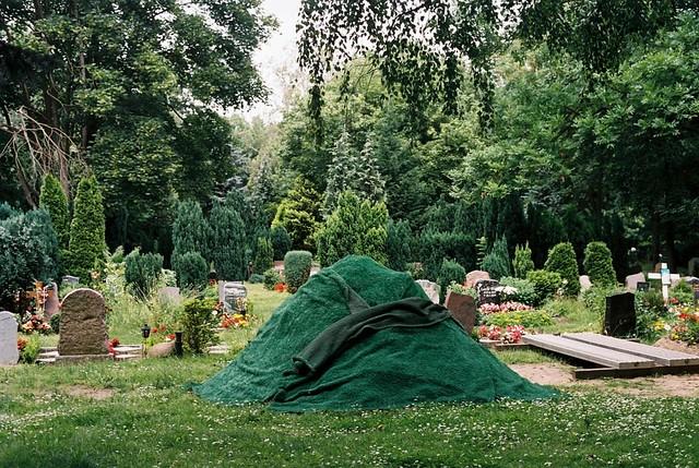 Astroturf mound in graveyard