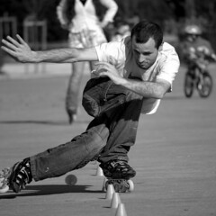 skateboarding--equipment and supplies(0.0), boardsport(0.0), skateboarding(0.0), skateboard(0.0), freestyle bmx(0.0), ice skating(0.0), longboarding(0.0), skating(1.0), roller sport(1.0), footwear(1.0), sports(1.0), monochrome photography(1.0), extreme sport(1.0), roller skates(1.0), monochrome(1.0), roller skating(1.0), black-and-white(1.0), black(1.0),