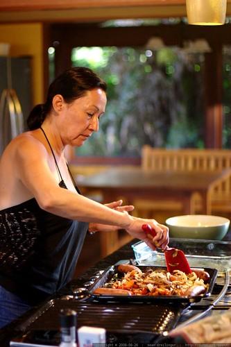 grandma neeta preparing roast vegetables and sausage    MG 0503