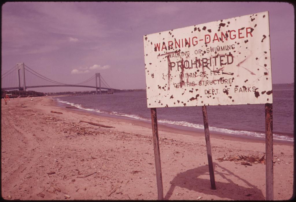 Warning of Polluted Water at Staten Island Beach Verrazano-Narrows Bridge in Background 06/1973