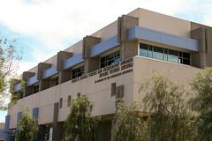 corporate headquarters(0.0), headquarters(0.0), plaza(0.0), campus(0.0), building(1.0), property(1.0), commercial building(1.0), architecture(1.0), brutalist architecture(1.0), condominium(1.0), facade(1.0),