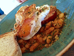 Bacon steak with fried duck egg and house baked be…
