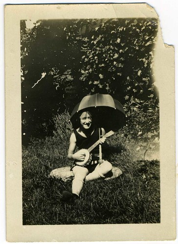 Snapshot: Backyard Woman With Umbrella And Banjo