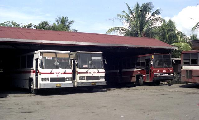 Batangas Laguna Tayabas Bus Co (BLTB Co) Fuso DVB-465 (fleet No 2) DVB-464 (fleet No 1) (fleet No 551) and another bus at the Company Terminal in Santa Cruz, Laguna, Philippines.